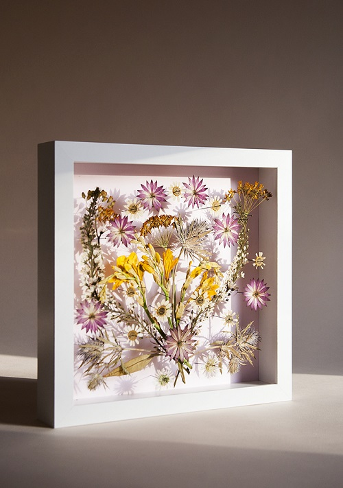 frame with pressed flowers inside