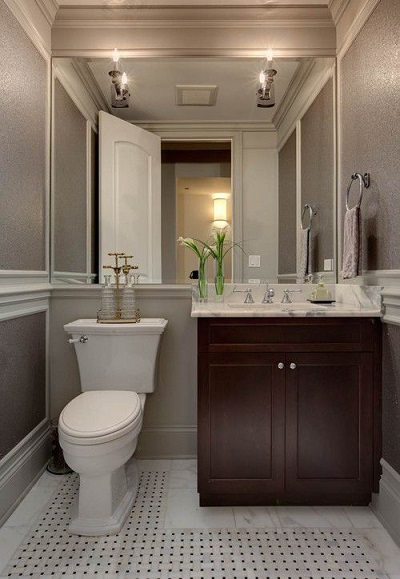 small bathroom with a large mirror