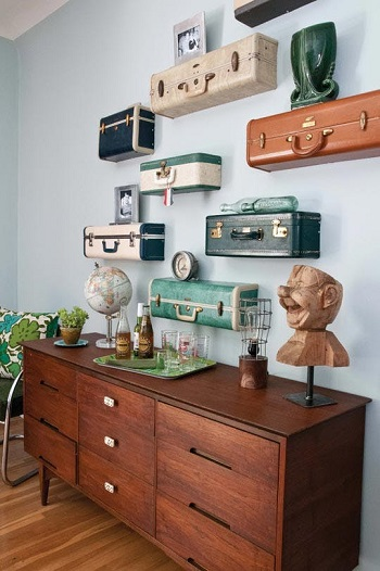 old suitcases repurposed as shelves