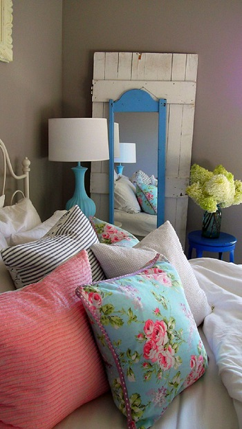 colorful decorative pillows on bed