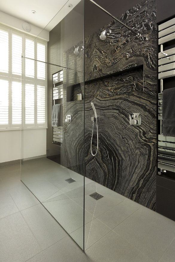 walk in shower with black marble
