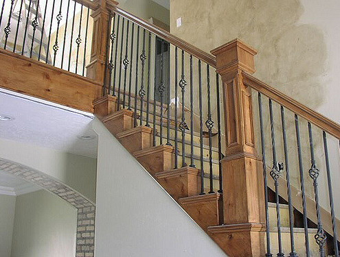 stair way at home that made in metal and wood accent