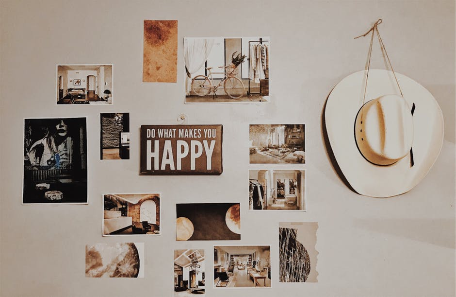 a picture ldge wall decor and hang with a dirty white hat .