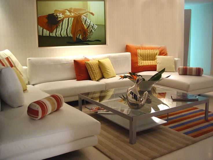 living room in small scale with wide wall frame and square glass table at the center