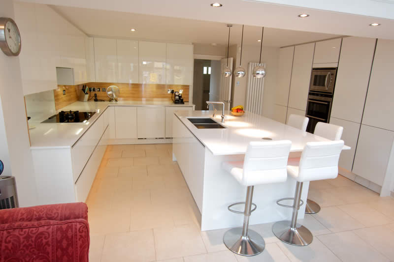white kitchen with extra seating on kitchen island