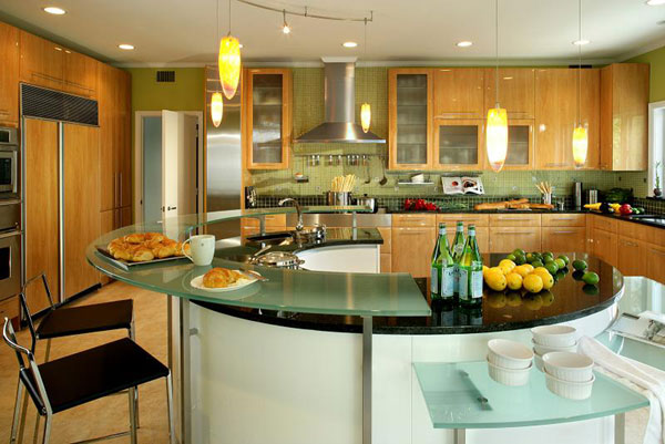 curvy kitchen island with a eat - in glass table and a marble kitchen island