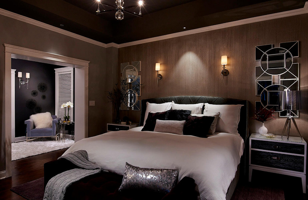 bedroom in dark accent with huge bed and wall lampshade