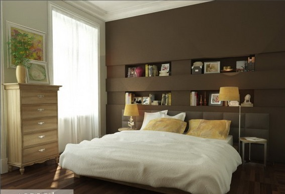 a small room with an brown and white  accent and a book shelf over the bed head board