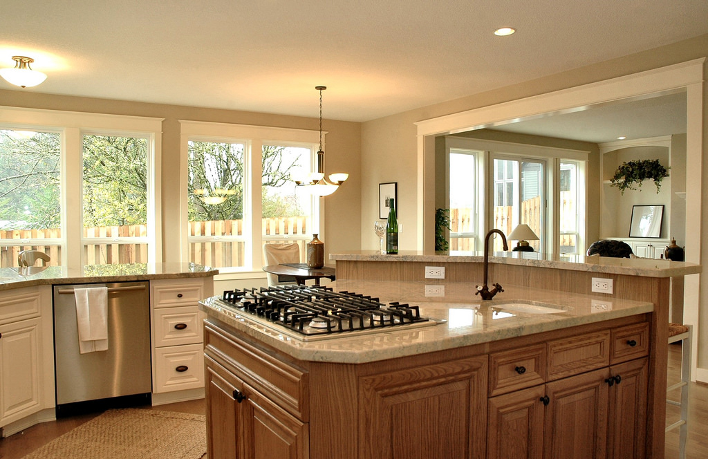 kitchen, which pairs rustic cabinets with a long line of windows allow for a beautiful view