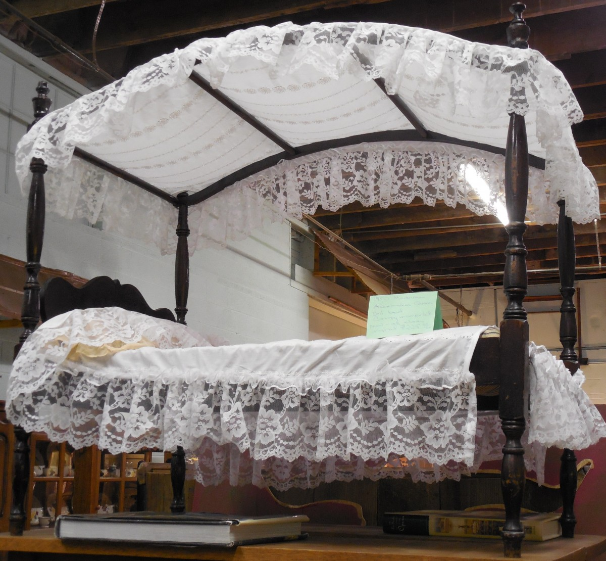 wood bed with hang  drape fabric above.