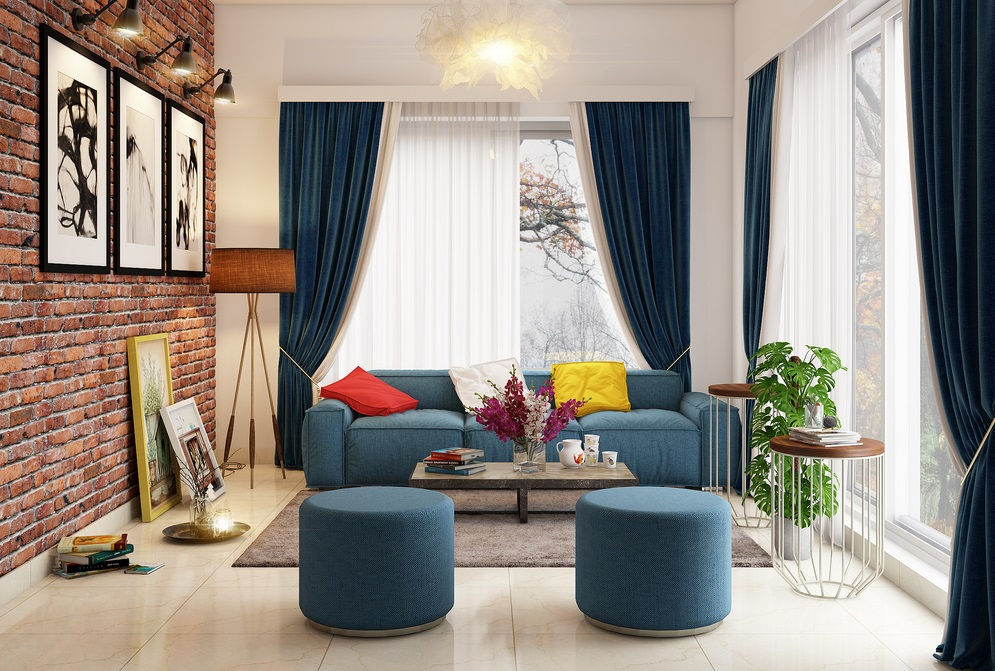 a living room with blue accent chairs and curtains with wall frame