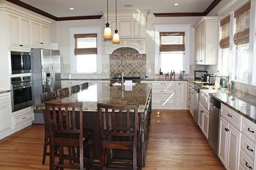 massive kitchen island with farmhouse sink