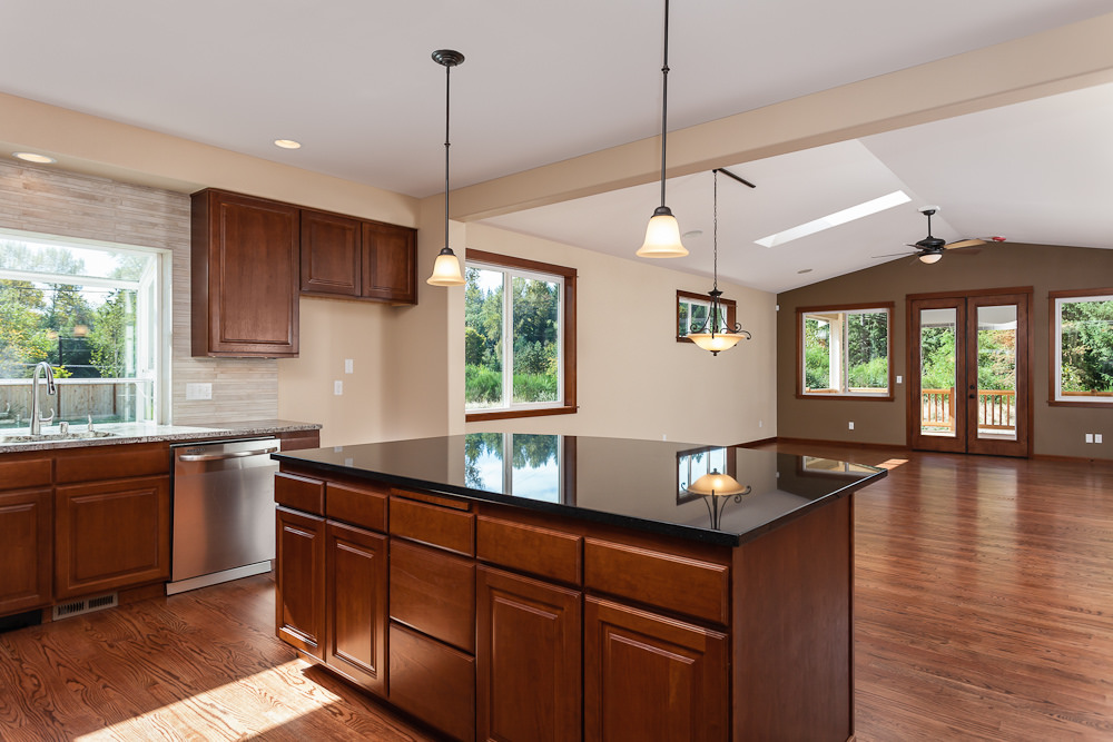 old world influence kitchen in a wood accent of floor and cabinets
