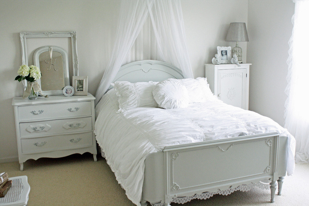 small bedroom in all white accent and a little white cabinet and mirror